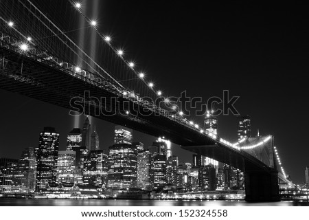 Brooklyn Bridge and the Towers of Lights (Tribute in Light) at Night, Manhattan, New York City - stock photo