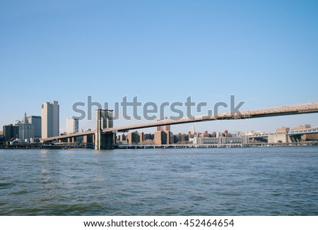 Brooklyn bridge at New York City view with sky and river from Brooklyn. Important landmarks in New York City. Symbolic of Big city, Business, Finance, New York Fashion Week. For your project design  - stock photo