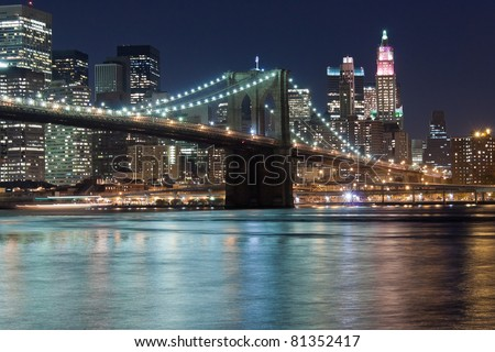 Brooklyn Bridge at night viewed from Fulton ferry state park - stock photo