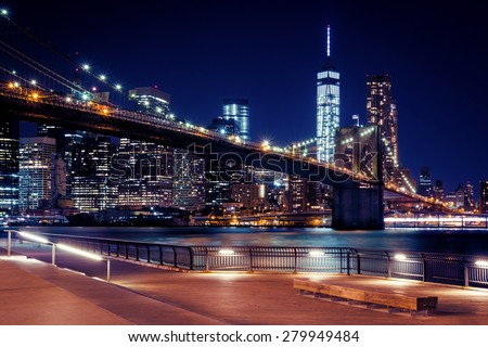 Brooklyn Bridge, Downtown Manhattan, New York. Night scene. Light trails. City lights. Urban living and transportation concept