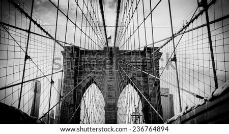 Brooklyn bridge, dramatic black and white photo - stock photo