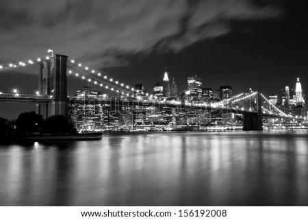 Brooklyn Bridge in black and white. Night scene - stock photo
