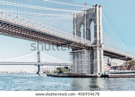 Brooklyn Bridge in New York City United States America  Famous suspension bridge in NYC USA, it connects Manhattan and Brooklyn by spanning the East River. Image with high key filter effect. - stock photo