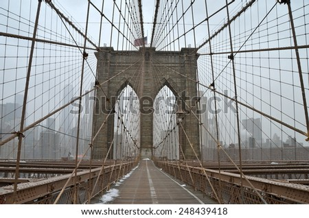 Brooklyn Bridge in the winter, New York City, USA. - stock photo