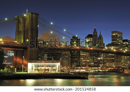 Brooklyn Bridge over East River at night in New York City - stock photo