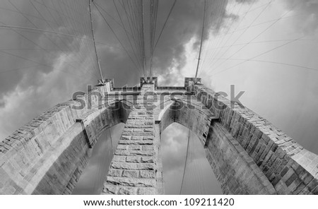 Brooklyn Bridge Pillar and Cable Pattern with dramatic Sky, Manhattan - New York City - stock photo