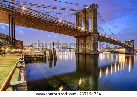 Brooklyn Bridge spanning the East River from Manhattan to Brooklyn in New York City, USA. - stock photo