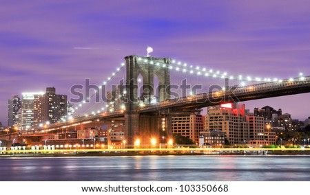 Brooklyn Bridge spanning the East River towards Brooklyn in New York City.