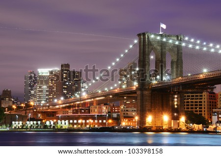 Brooklyn Bridge spanning the East River towards Manhattan in New York City. - stock photo