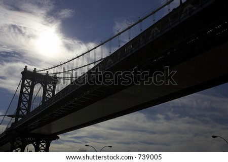 Brooklyn Bridge spanning the east river, viewed from underneath and into the sun, Manhattan, New York, America, usa