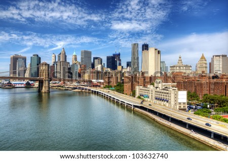 Brooklyn Bridge spans the East River towards Lower Manhattan in New York City. - stock photo