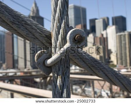 Brooklyn Bridge steel cable close up. - stock photo