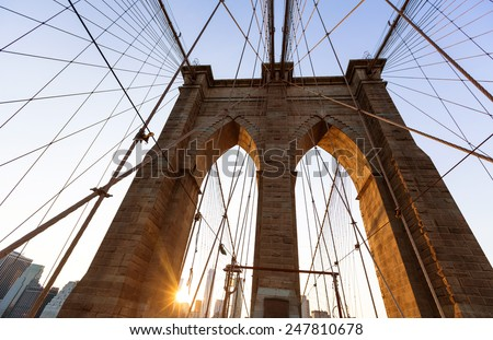Brooklyn Bridge sunset with Manhattan skyline of New York City USA - stock photo