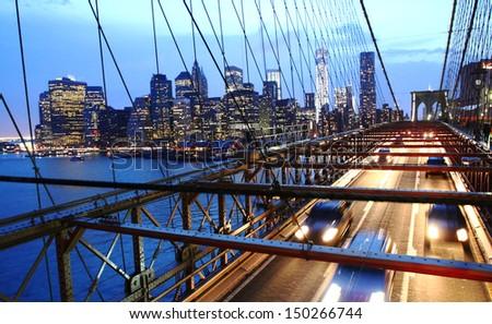 Brooklyn bridge traffic at night, close up - stock photo