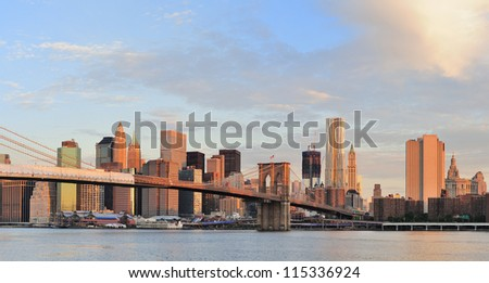 Brooklyn Bridge with lower Manhattan skyline panorama in the morning with colorful cloud over East River in New York City - stock photo