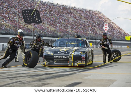 BROOKLYN, MI - JUN 17, 2012:  Ryan Newman (39) brings in his US Army Chevrolet for service during the Quicken Loans 400 at the Michigan International Speedway in Brooklyn, MI on June 17, 2012. - stock photo