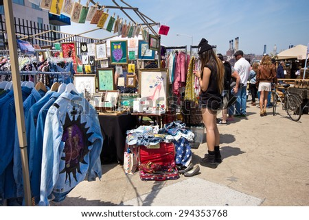 BROOKLYN, NEW YORK - APRIL 28, 2013:  Scene at famous Brooklyn Flea Market in Williamsburg Brooklyn in New York City with people visible. - stock photo