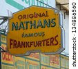 BROOKLYN, NEW YORK - APRIL 9 : The Nathan's original restaurant sign on April 9, 2013 at Coney Island, New York. The original Nathan's still exists on the same site that it did in 1916. - stock photo