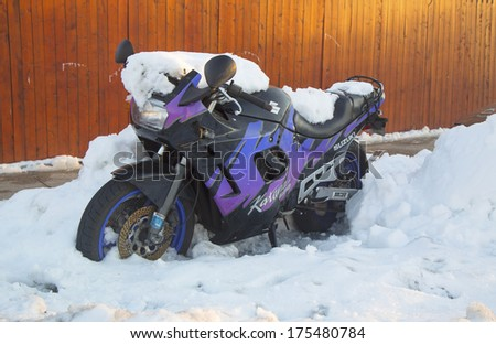 BROOKLYN, NEW YORK - FEBRUARY 6: Suzuki motorcycle under snow on February 6, 2014 in Brooklyn, NY after massive winter storms strikes Northeast.
