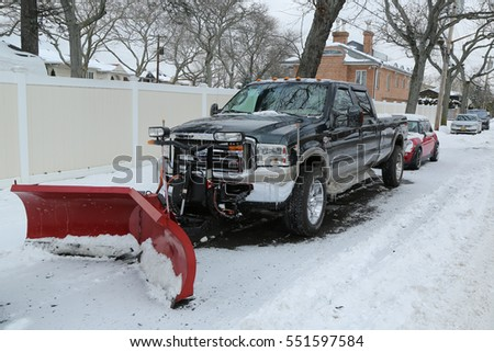 BROOKLYN, NEW YORK - JANUARY 8, 2017: Snow plow truck in Brooklyn, NY ready to clean streets after massive Winter Storm Helen strikes Northeast