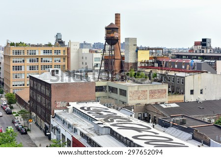 Brooklyn, New York - July 12, 2015: Graffiti covered buildings in  Williamsburg, Brooklyn. Williamsburg has become known as an arts and culture mecca in New York city. - stock photo