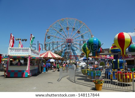 BROOKLYN, NEW YORK - JULY 30 :Wonder Wheel at the Coney Island amusement park on July 30, 2013. Deno's Wonder Wheel a hundred and fifty foot eccentric Ferris wheel. This wheel was built in 1920  - stock photo