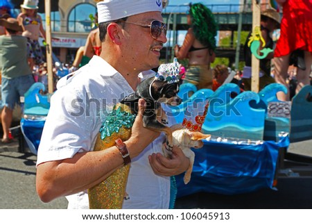 BROOKLYN, NEW YORK - 23 JUNE 2012: celebrants don aquatic-themed costumes in honor of Brooklyn's annual Mermaid Parade on 23 June 2012 in Brooklyn, New York.