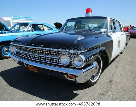 BROOKLYN, NEW YORK - JUNE 12, 2016: Historical 1961 Ford Police car on display at the Antique Automobile Association of Brooklyn annual Spring Car Show  - stock photo