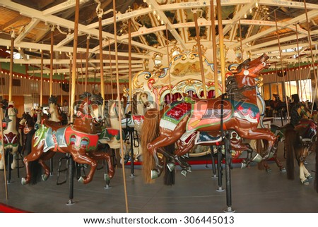 BROOKLYN, NEW YORK - JUNE 7, 2015: Horses on a traditional fairground B&B carousel at historic Coney Island Boardwalk in Brooklyn