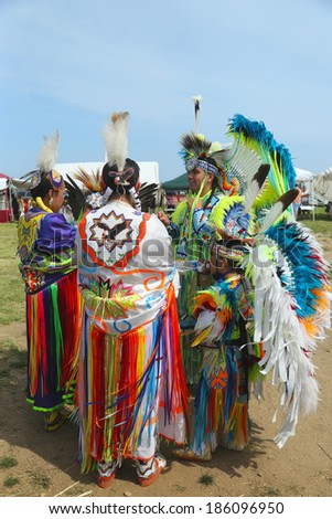 BROOKLYN, NEW YORK - JUNE 2:Unidentified Native American family at the NYC Pow Wow in Brooklyn on June 2, 2013. A pow-wow is a gathering and Heritage Celebration of North America s Native people  - stock photo