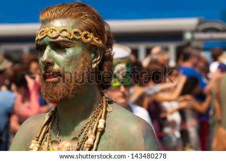 BROOKLYN, NEW YORK - JUNE 22: Unidentified participant of the 29th annual Coney Island Mermaid Parade on June 22, 2013 at Coney Island, Brooklyn, NY, USA. - stock photo