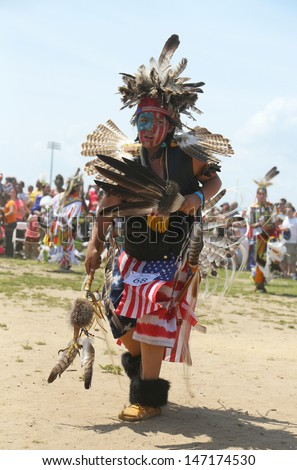 BROOKLYN, NEW YORK - JUNE 2:Unidentified young Native American dancer at the NYC Pow Wow in Brooklyn on June 2, 2013.A pow-wow is a gathering and Heritage Celebration of North America s Native people