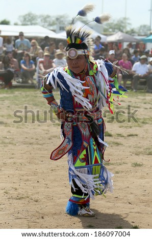 BROOKLYN, NEW YORK - JUNE 2:Unidentified young Native American dancer at the NYC Pow Wow in Brooklyn on June 2, 2013. A pow-wow is a gathering and Heritage Celebration of North America s Native people - stock photo