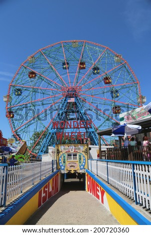 BROOKLYN, NEW YORK - JUNE 15: Wonder Wheel at the Coney Island amusement park on June 15, 2014. Deno's Wonder Wheel a hundred and fifty foot eccentric Ferris wheel. This wheel was built in 1920 - stock photo
