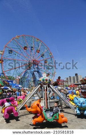 BROOKLYN, NEW YORK - JUNE 15:Wonder Wheel at the Coney Island amusement park on June 15, 2014. Deno's Wonder Wheel a hundred and fifty foot eccentric Ferris wheel. This wheel was built in 1920  - stock photo