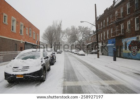 BROOKLYN, NEW YORK - MARCH 5, 2015: Cars under snow in Brooklyn, NY during massive Winter Storm Thor