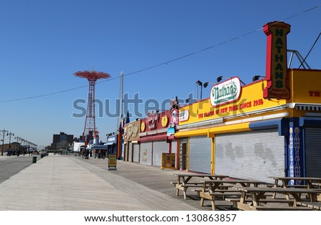 BROOKLYN, NEW YORK - MARCH 5: Coney Island Boardwalk with Parachute Jump in the background on March 5, 2013 at Coney Island, NY. The boardwalk, built in 1923, stretches for 2.51 miles.
