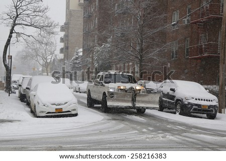 BROOKLYN, NEW YORK - MARCH 5, 2015: Snow plow truck in Brooklyn, NY during massive Winter Storm Thor