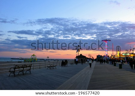 BROOKLYN, NEW YORK - MAY 31 Coney Island Boardwalk with Parachute Jump in the background on May 31, 2014 at Coney Island, NY The boardwalk, built in 1923, stretches for 2 51 miles - stock photo