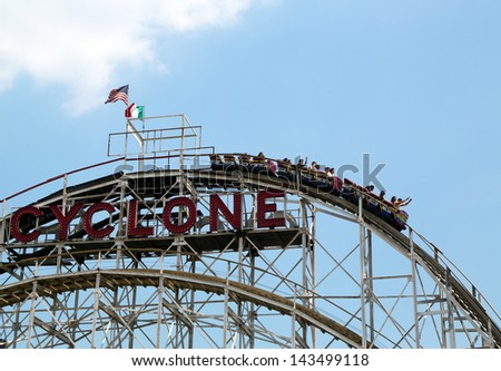 BROOKLYN, NEW YORK - MAY 30:Historical landmark Cyclone roller coaster on May 30, 2013 in the Coney Island section of Brooklyn. Cyclone is a historic wooden roller coaster opened on June 26, 1927