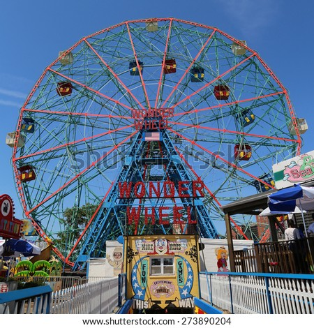 BROOKLYN, NEW YORK - MAY 17, 2014: Wonder Wheel at the Coney Island amusement park.  Deno's Wonder Wheel a hundred and fifty foot eccentric Ferris wheel. This wheel was built in 1920 - stock photo