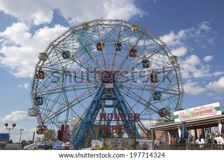 BROOKLYN, NEW YORK - MAY 17:Wonder Wheel at the Coney Island amusement park on May 17, 2014. Deno's Wonder Wheel a hundred and fifty foot eccentric Ferris wheel. This wheel was built in 1920  - stock photo