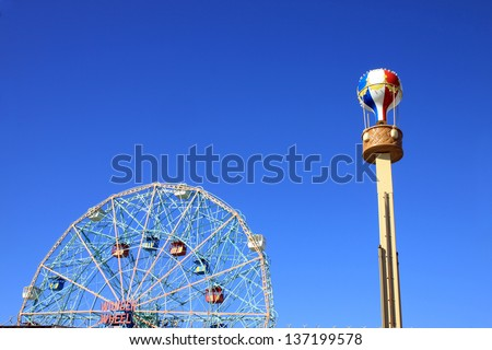 BROOKLYN, NEW YORK - OCTOBER 16: Wonder Wheel at the Coney Island amusement park on October 16, 2012. Deno's Wonder Wheel a hundred and fifty foot eccentric Ferris wheel. This wheel was built in 1920  - stock photo
