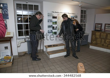 BROOKLYN, NEW YORK, USA - NOVEMBER 22: Raymond Sawyers holds wooden cross while  members of the borough paranormal meetup group of NY investigate the Old Stone House.  Taken November 22, 2015 in NY. - stock photo