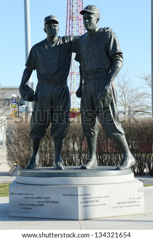 BROOKLYN, NY - APRIL 6: Jackie Robinson and  Pee Wee Reese Statue in Brooklyn in front of MCU ballpark on April 6, 2013. 42 is an upcoming 2013 Hollywood film about baseball player Jackie Robinson - stock photo