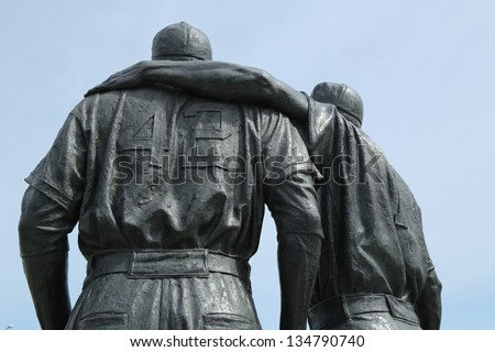 BROOKLYN, NY - APRIL 9: Jackie Robinson and Pee Wee Reese Statue in Brooklyn in front of MCU ballpark on April 9, 2013. 42 is an upcoming 2013 Hollywood film about baseball player Jackie Robinson - stock photo