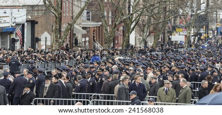 Brooklyn, NY - January 04, 2015: Police officers from around the country gather outside Aievoli Funeral Home for the funeral of slain New York City Police Officer Wenjian Liu