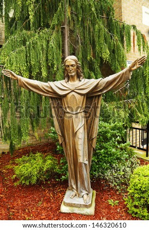 BROOKLYN, NY - JULY 13:Bronze Statue of Jesus Christ  in front  of Church of Mary Queen of Haven in Brooklyn on July 13, 2013.Queen of Heaven is a title given to the Blessed Virgin Mary by Christians  - stock photo