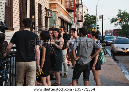 BROOKLYN, NY - JUNE 20:  Attendees outside of the Northside Festival screening of Ai WeiWei: Never Sorry, directed by Alison Klayman, presented by IFC at UnionDocs in Brooklyn, NY on June 20,2012. - stock photo
