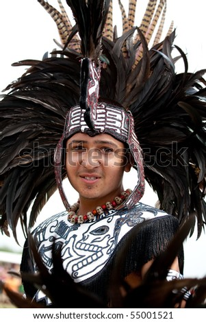 BROOKLYN, NY - JUNE 6: Aztec dancers at the Native American Festival at Floyd Bennett Field on June 6, 2010 in Brooklyn, NY. - stock photo